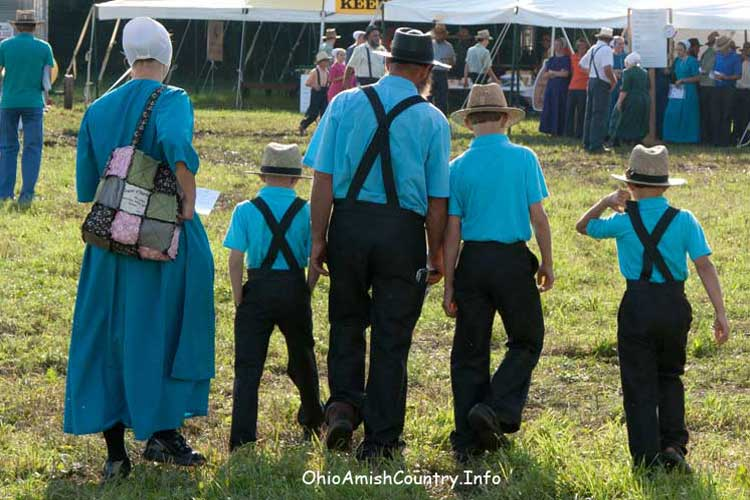 An Amish Family at Family Farm and Field Days.